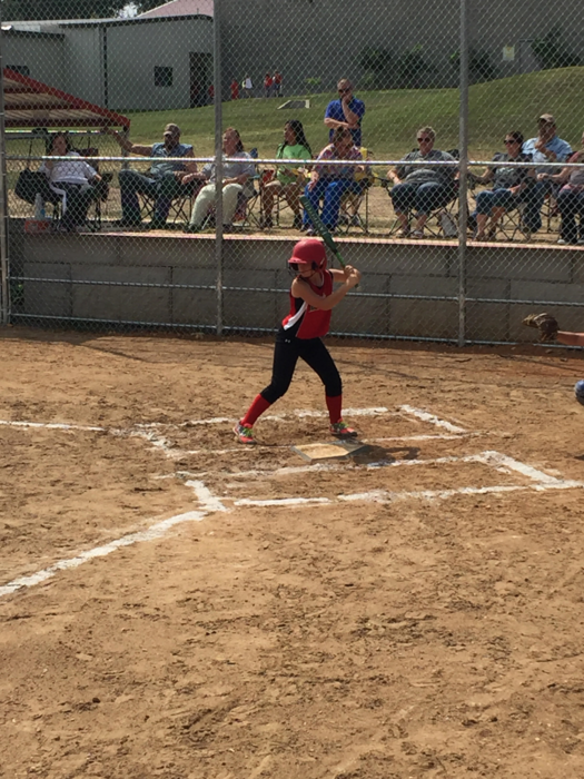 8th grade Lady Mustang at bat